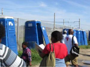 SJC members inspect Mshengu toilets.  Photo courtesy of Sowmya Kidambi
